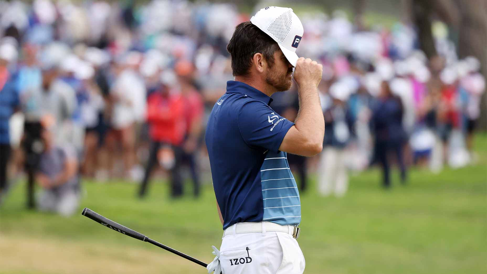 Louie Oosthuizen fixes his hat at the us open.