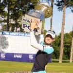nelly korda holds trophy