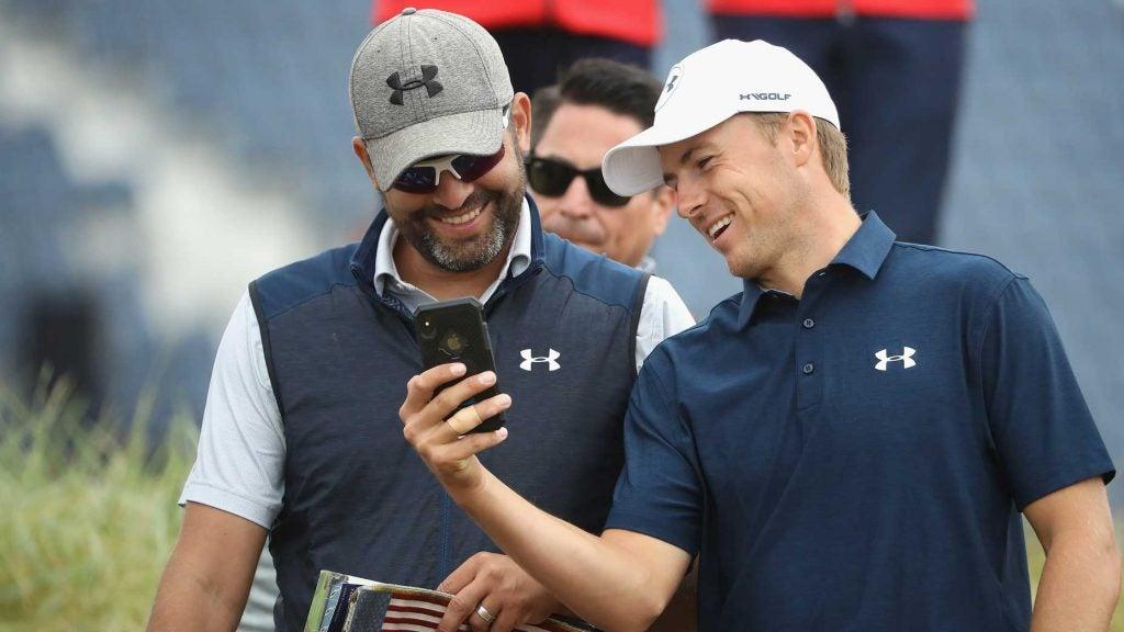 jordan spieth and michael greller laugh at phone
