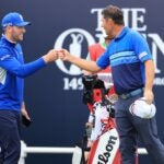 Padraig Harrington and Sam Forgan on the first tee at the Open Championship.
