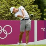 Collin Morikawa takes a swing during a practice round in Japan.