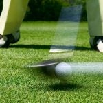 Person teeing off in blurred motion