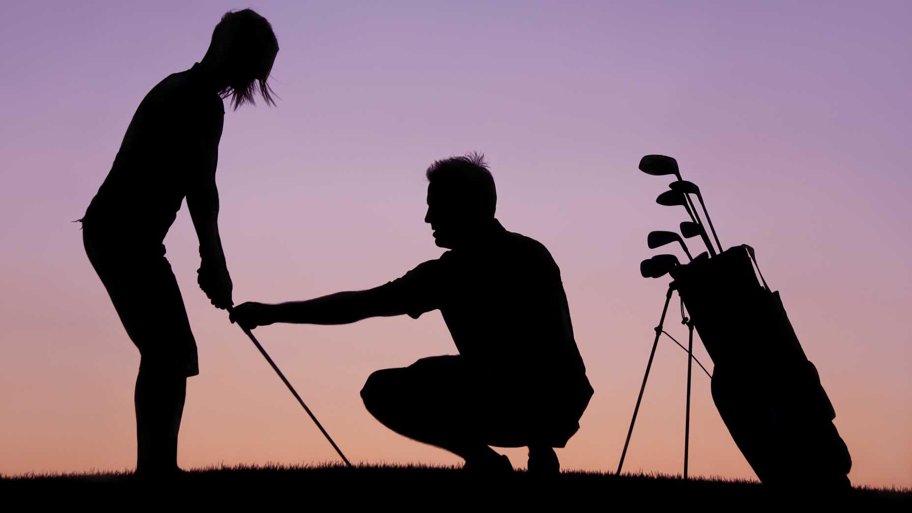 man teaches golf