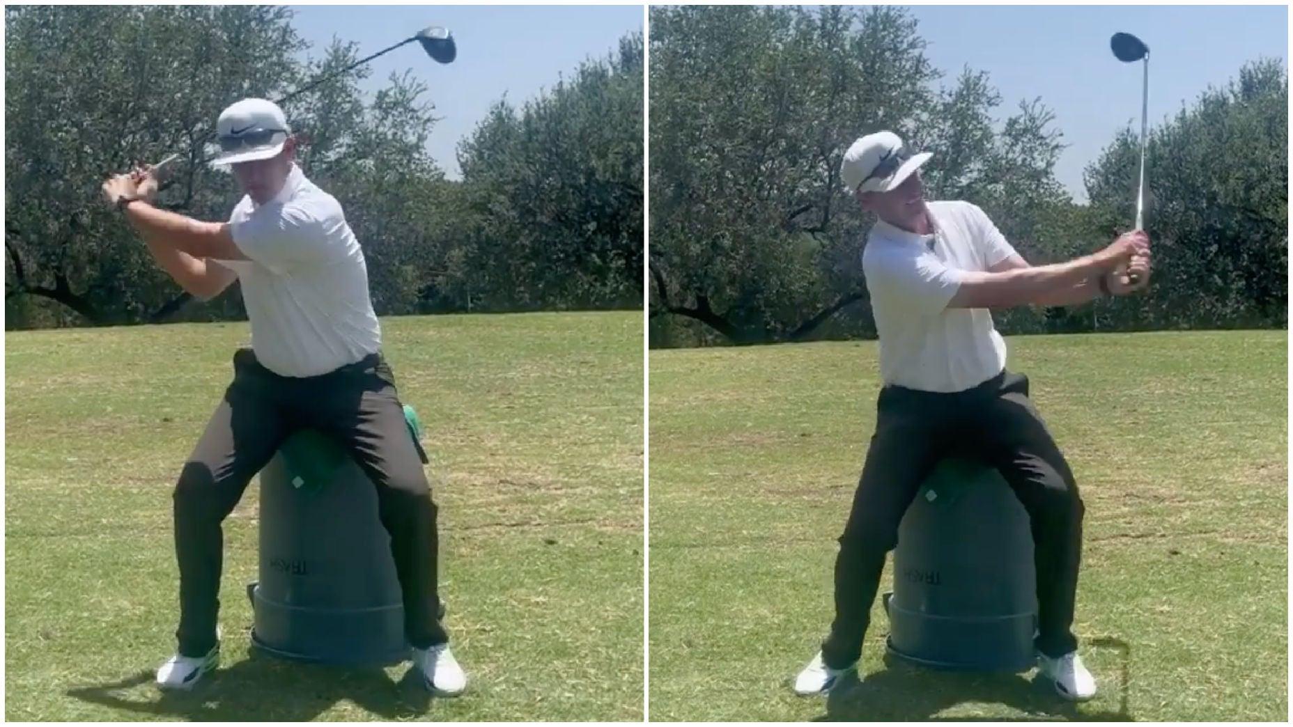 golf teacher demonstrates drill