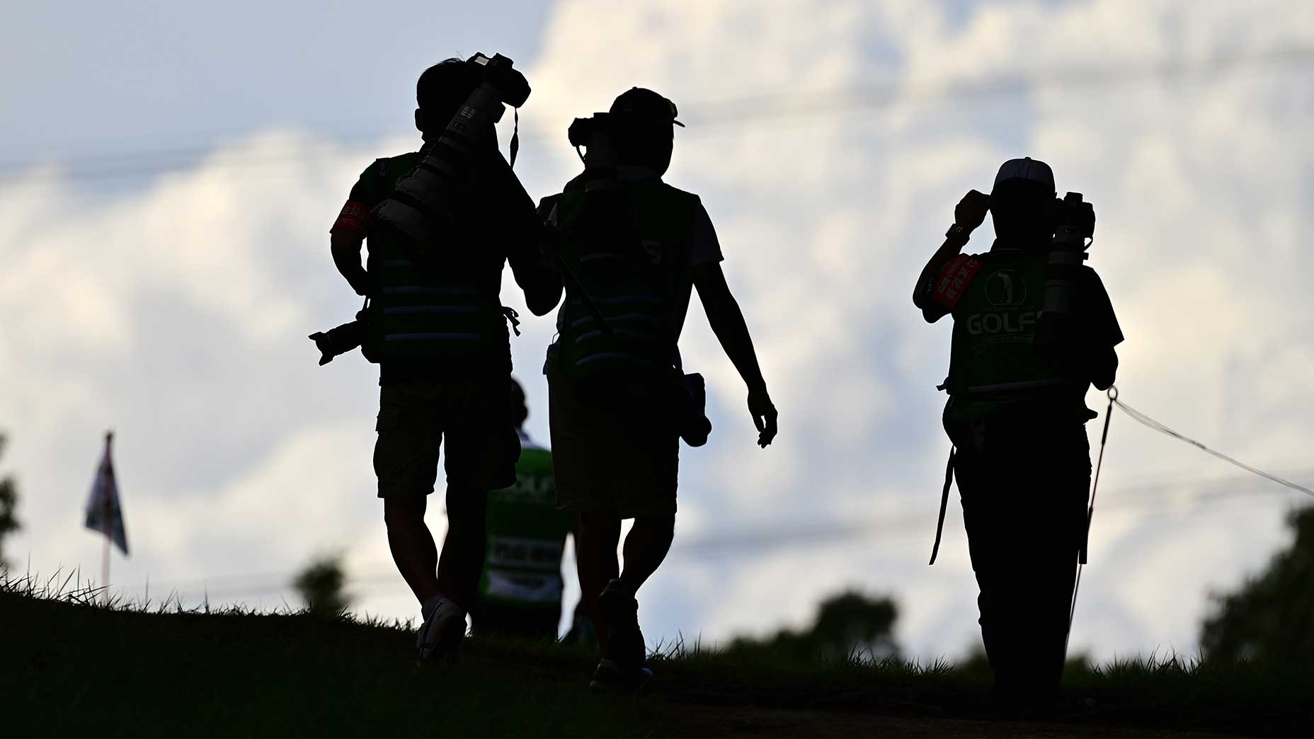 Reporters covering golf