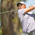 Norman Xiong hits a tee shot.