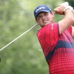 Patrick Reed takes a swing.