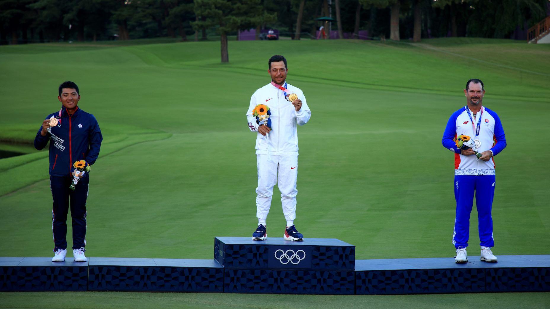golfers on podium