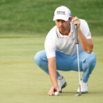 cantlay lining up putt at bmw