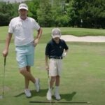 ian poulter stands with his son