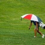 player hides under umbrella