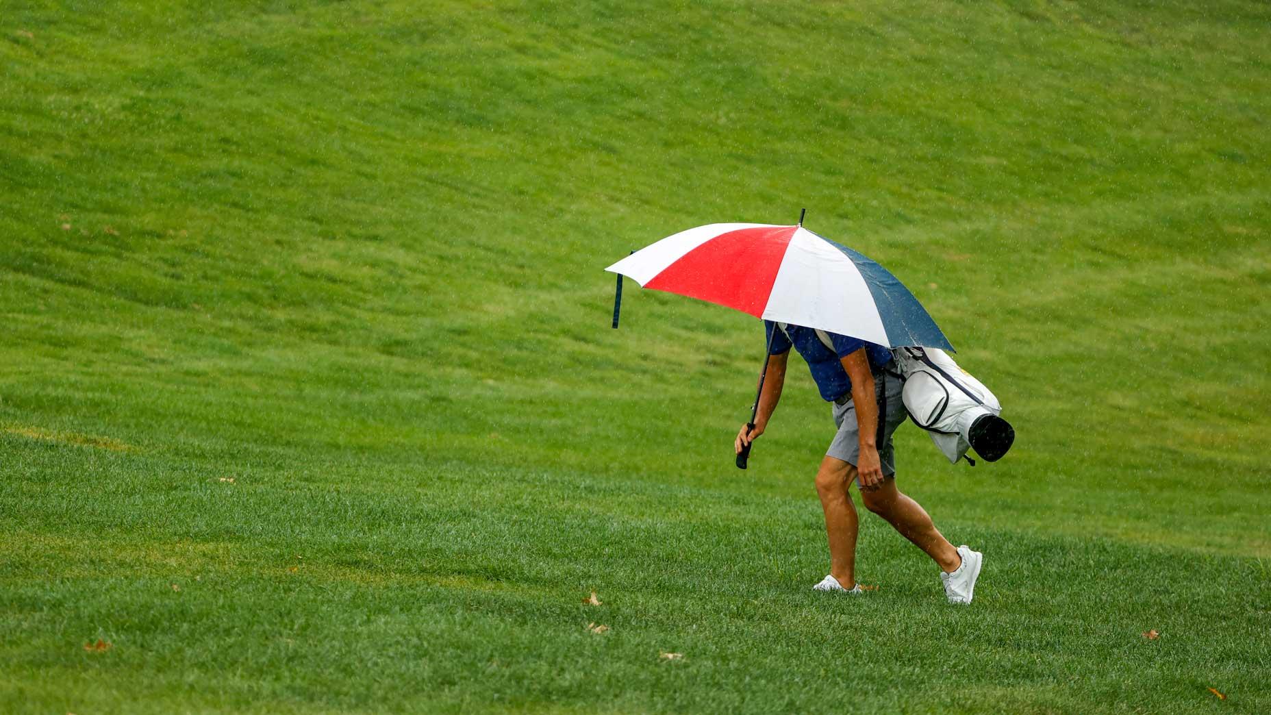 the player hides under an umbrella