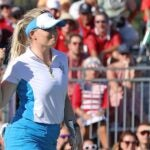 Matilda Castren pumps her fist after winning her match and retaining the Solheim Cup for Europe.
