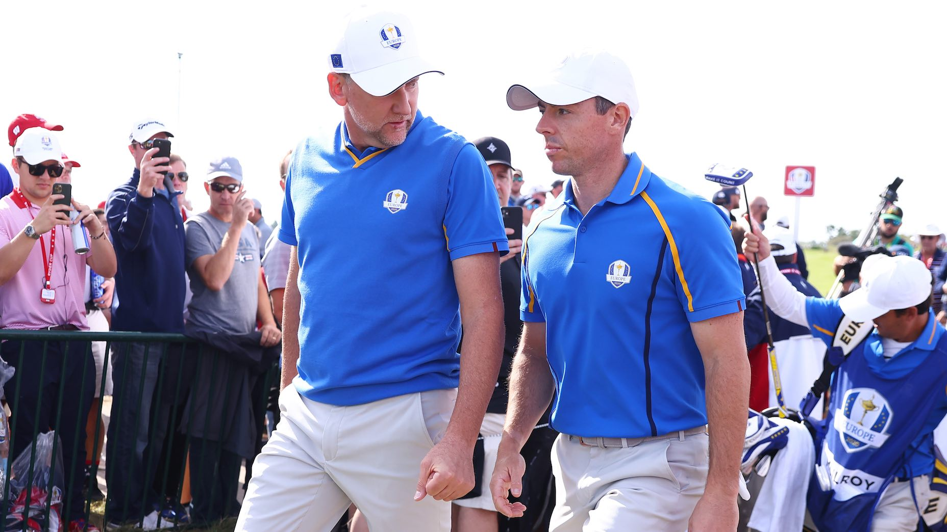 KOHLER, WISCONSIN - SEPTEMBER 24: Ian Poulter of England and team Europe (L) and Rory McIlroy of Northern Ireland and team Europe walk across the course during Friday Morning Foursome Matches of the 43rd Ryder Cup at Whistling Straits on September 24, 2021 in Kohler, Wisconsin. (Photo by Warren Little/Getty Images)