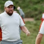 Shane Lowry grimaces in celebration facing partner Tyrrell Hatton at the 2021 Ryder Cup.