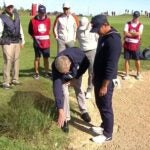 brooks koepka talks to a rules official at the ryder cup
