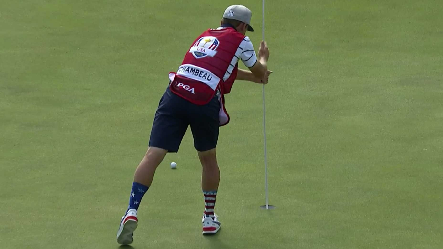 bryson's caddie with flagstick
