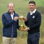 two men with trophy