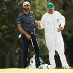 dustin johnson and his brother stand