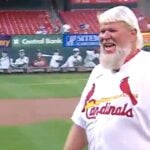 John Daly throws out the first pitch at the St. Louis Cardinals game.