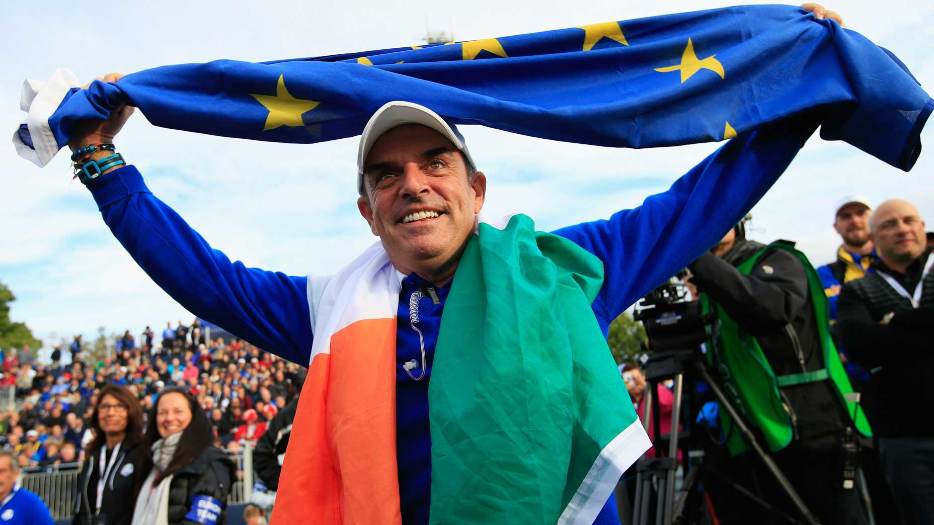 paul mcginley with flag over his head