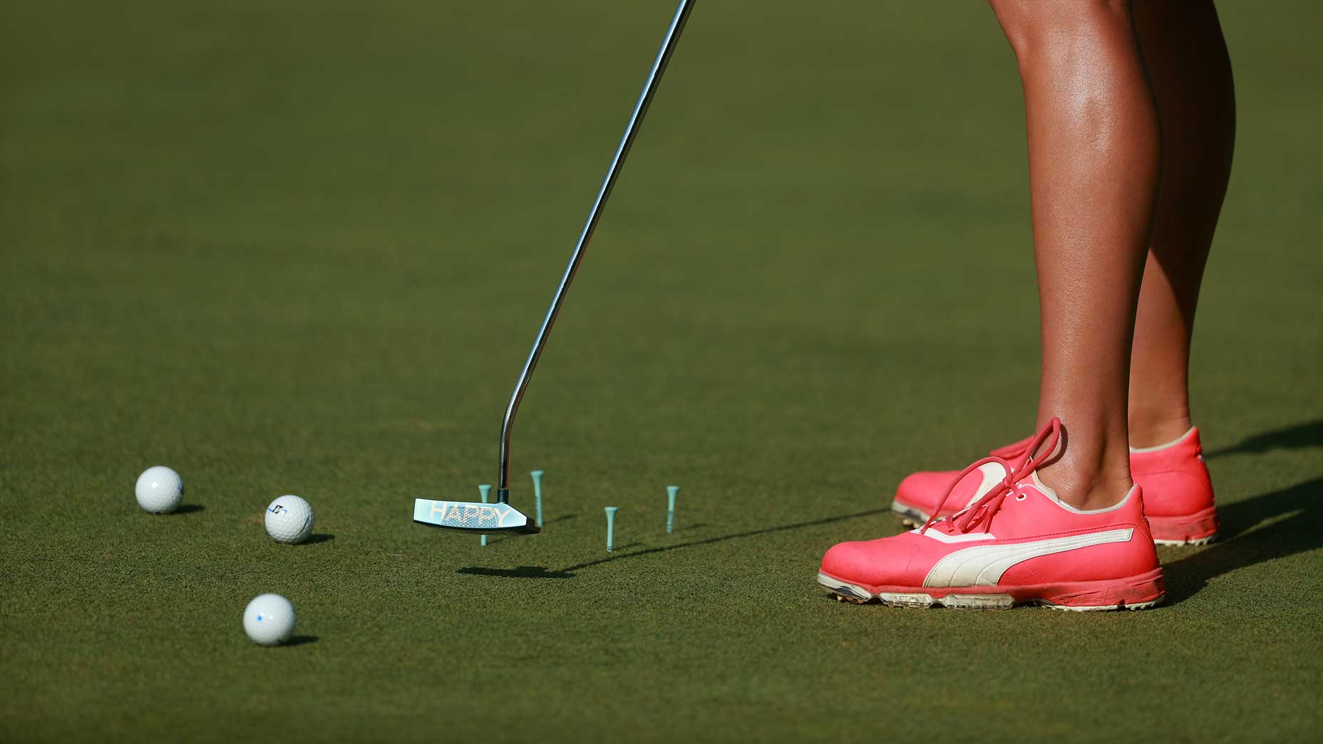 girl practices putting