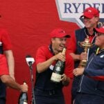 the us ryder cup team celebrates.
