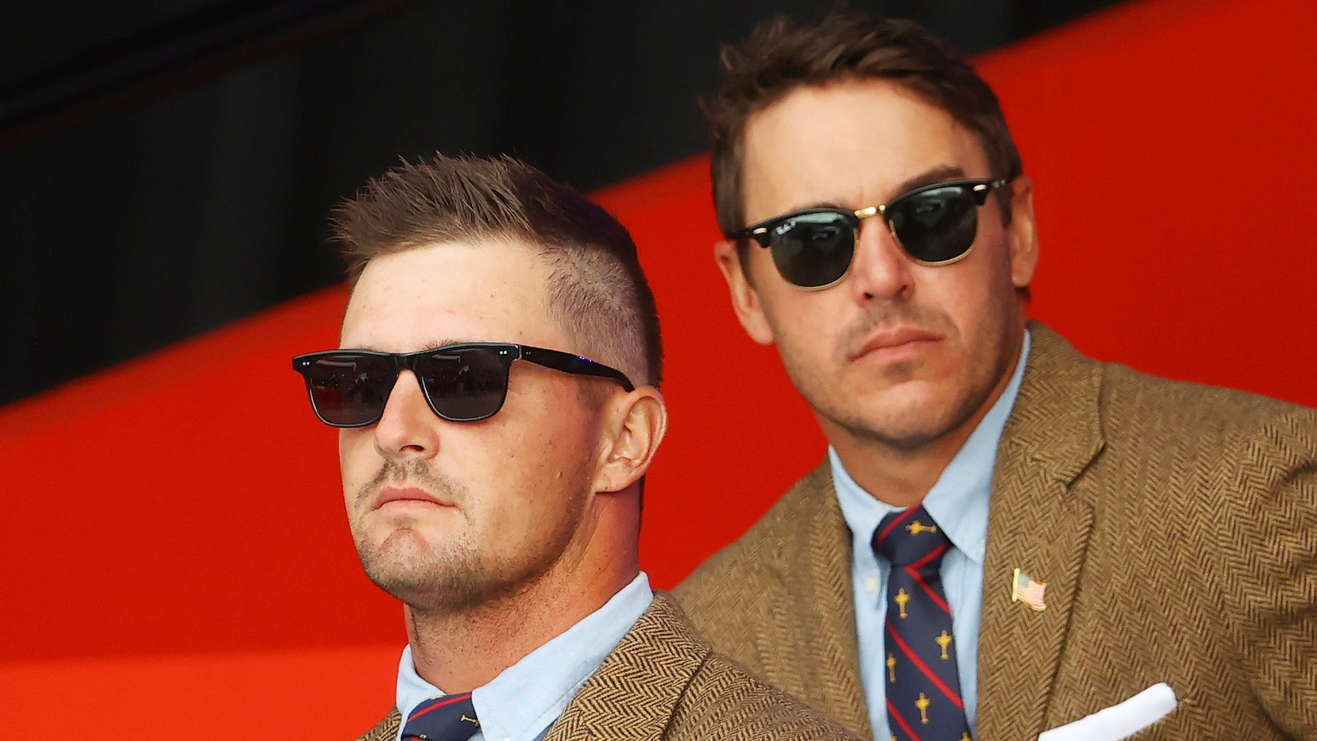 KOHLER, WISCONSIN - SEPTEMBER 23: Bryson DeChambeau of team United States and Brooks Koepka of team United States attend the opening ceremony for the 43rd Ryder Cup at Whistling Straits on September 23, 2021 in Kohler, Wisconsin. (Photo by Andrew Redington/Getty Images)