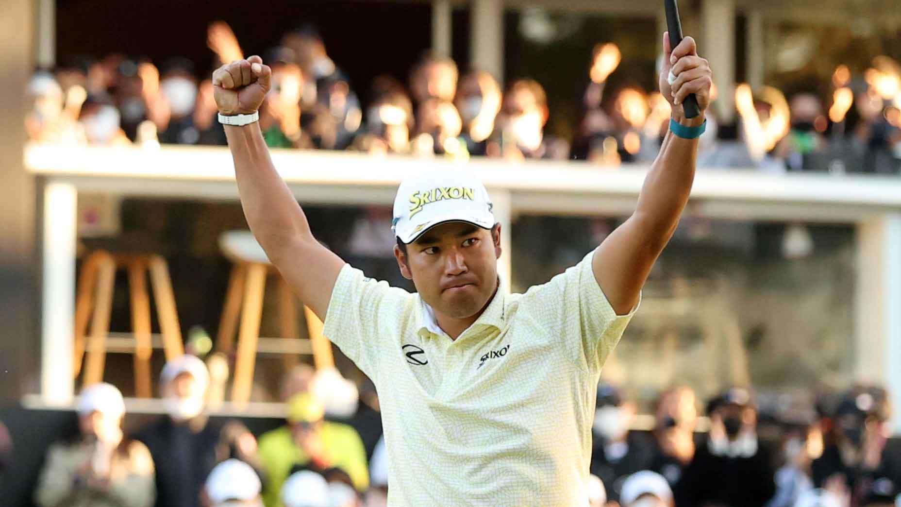 Hideki Matsuyama raises his arms in victory