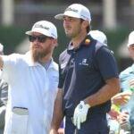 Caddie Joe Greiner advises Max Homa on a shot