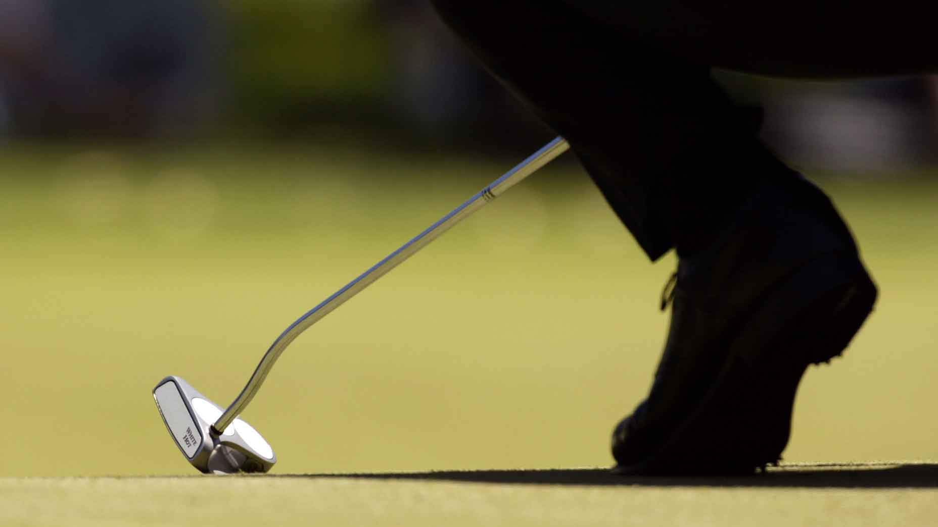 A player uses an Odyssey Two Ball putter