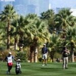 Rory McIlroy hits a shot against the Las Vegas skyline