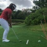 a player uses alignment sticks to practice different trajectories