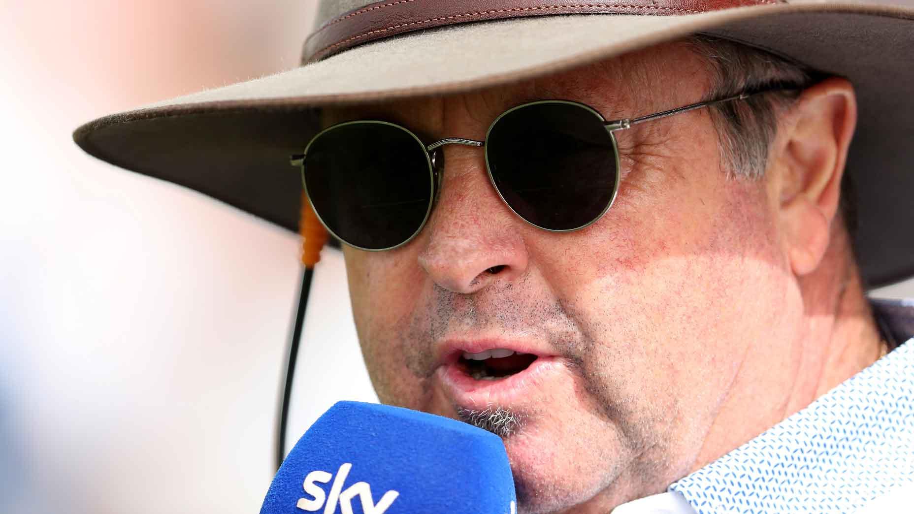 Wayne Riley speaks into his Sky Sports microphone