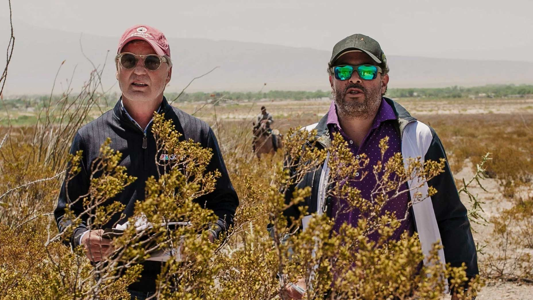Augustin Piza and Brandel Chamblee stand in tall grass at the Butterfly Effect / Desertica project