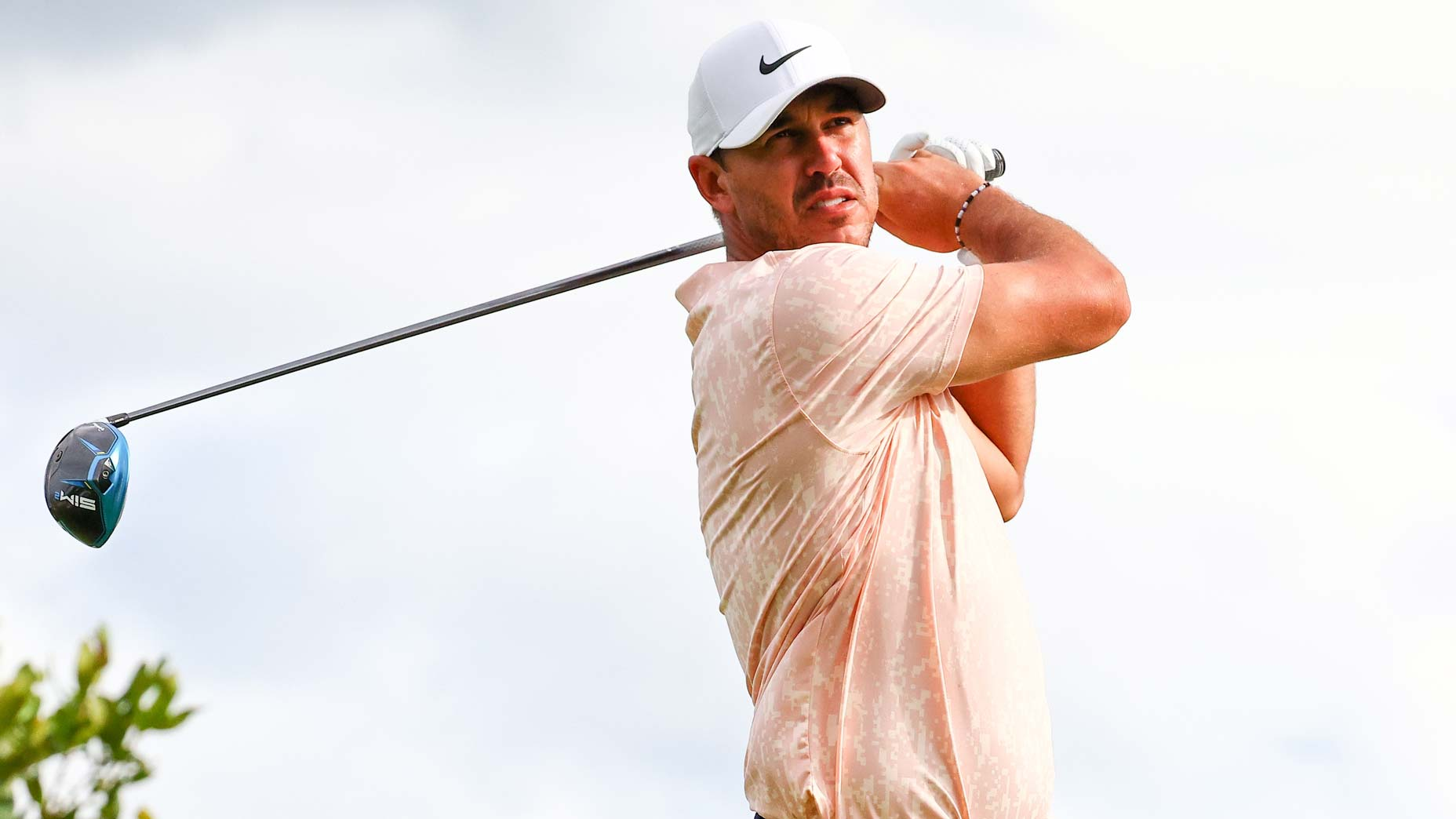 Brooks Koepka hits tee shot during the 2021 Northern Trust golf tournament
