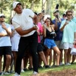 Brooks Koepka plays a golf shot during the 2021 Tour Championship at East Lake