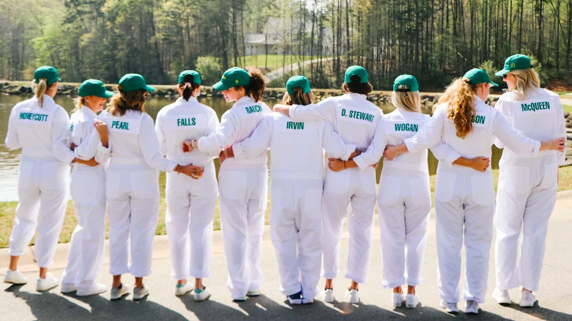 A group of people wearing white caddie bibs