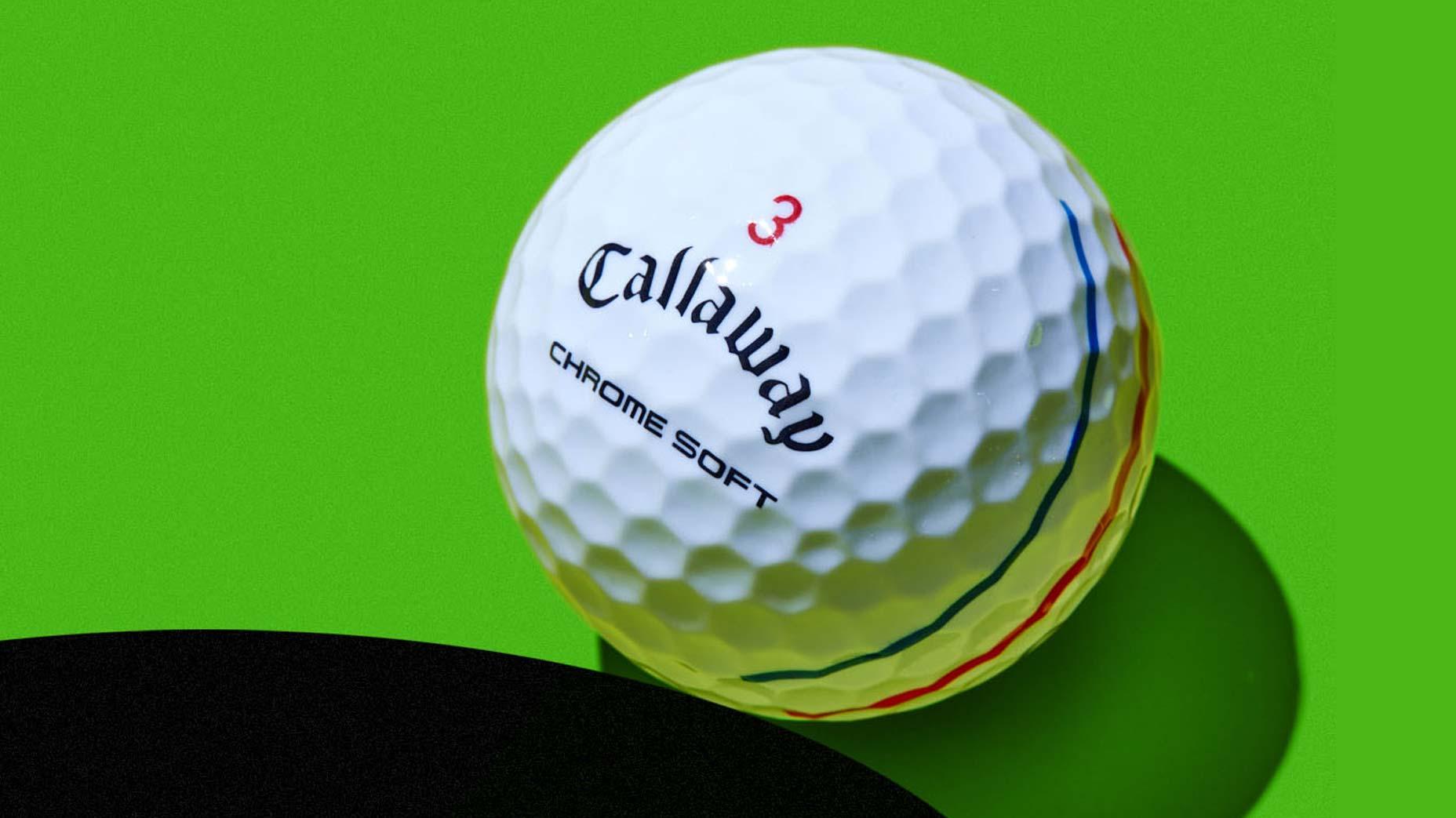 A Callaway Chrome Soft Triple Track golf ball against a green background