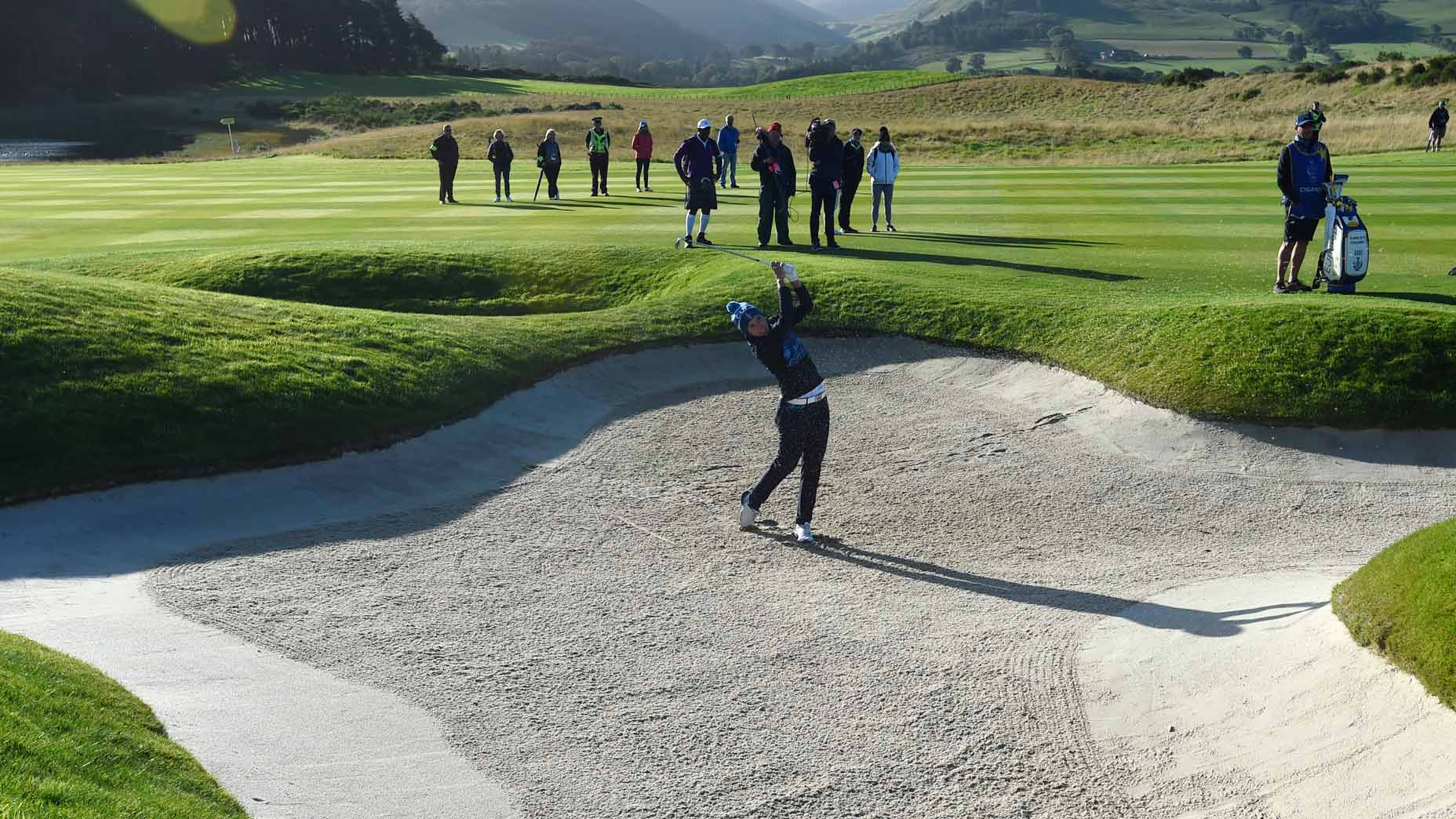 Carlota Ciganda hits from a fairway bunker during the Solheim Cup