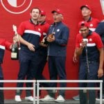 U.S. Ryder Cup captain Fred Couples holds champagne with U.S. players during victory celebration