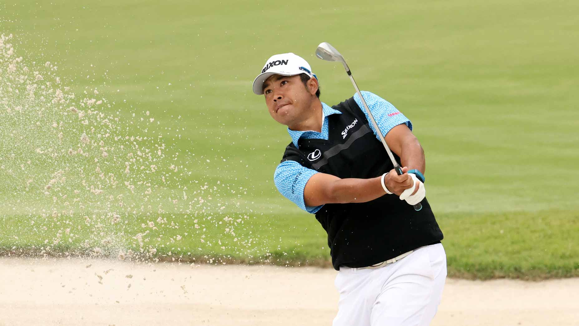 Hideki Matsuyama hits out of a bunker during the first round of the 2021 Zozo Championship in Japan