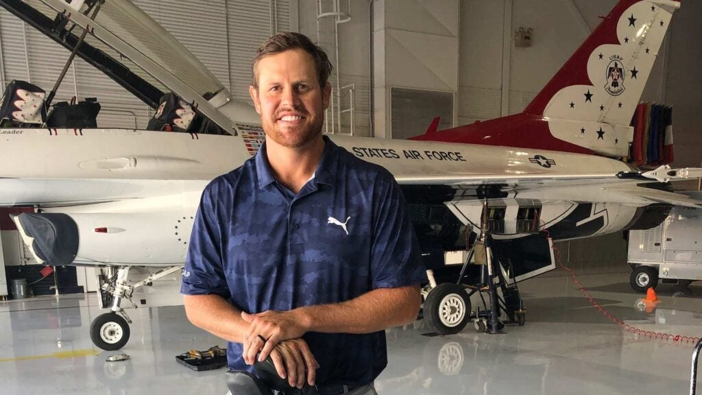 Kyle Westmoreland poses in front of a Thunderbirds fighter jet