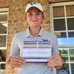 High school golfer Macy Pate holds up scorecard for her round of 57