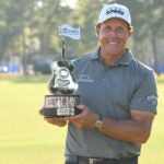 phil mickelson with trophy