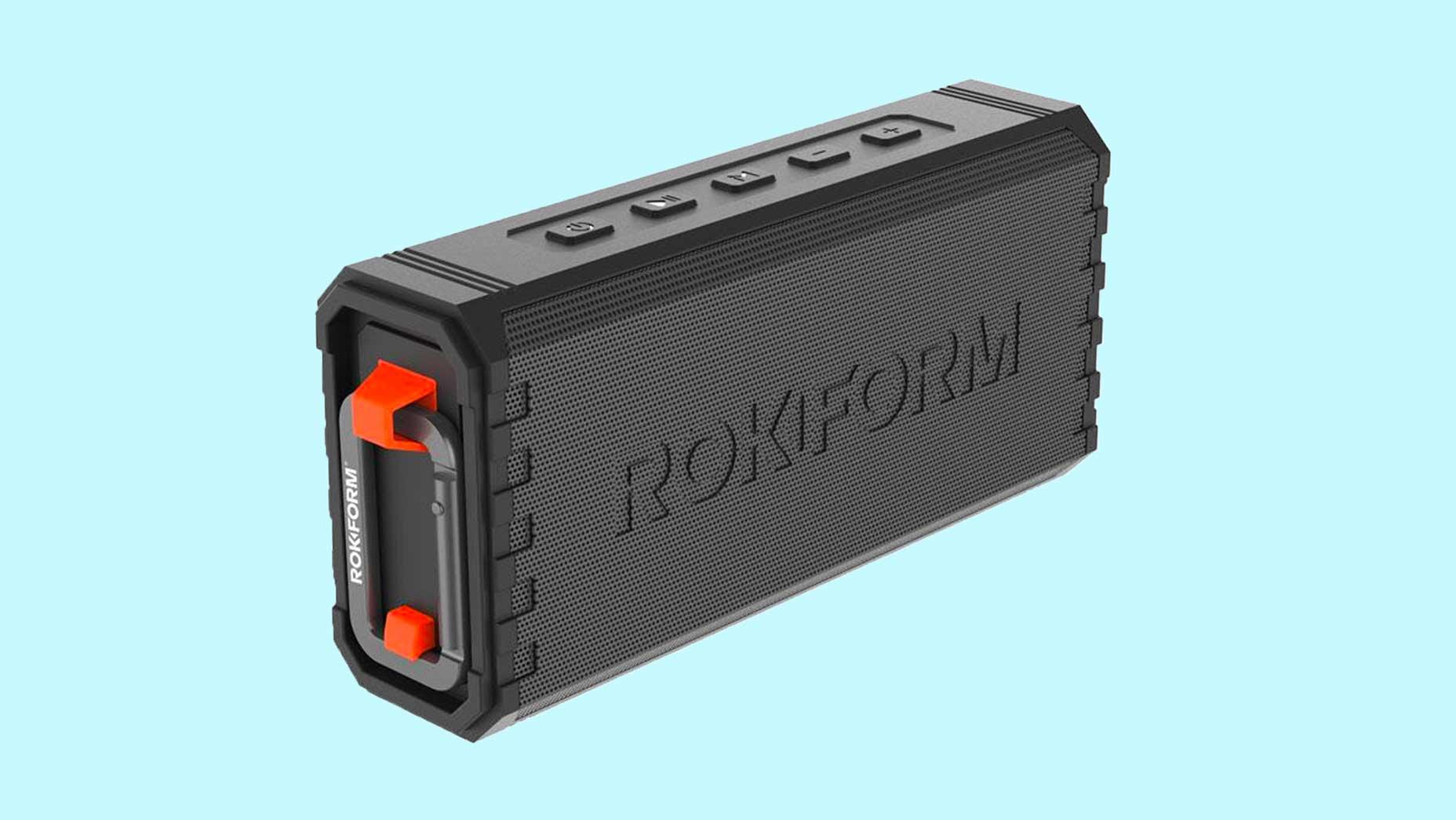 The G-ROK Wireless Golf speaker. against light blue background