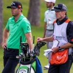 Sam Burns waits in fairway with caddie and golf bag at 2021 Shriners Children's Open