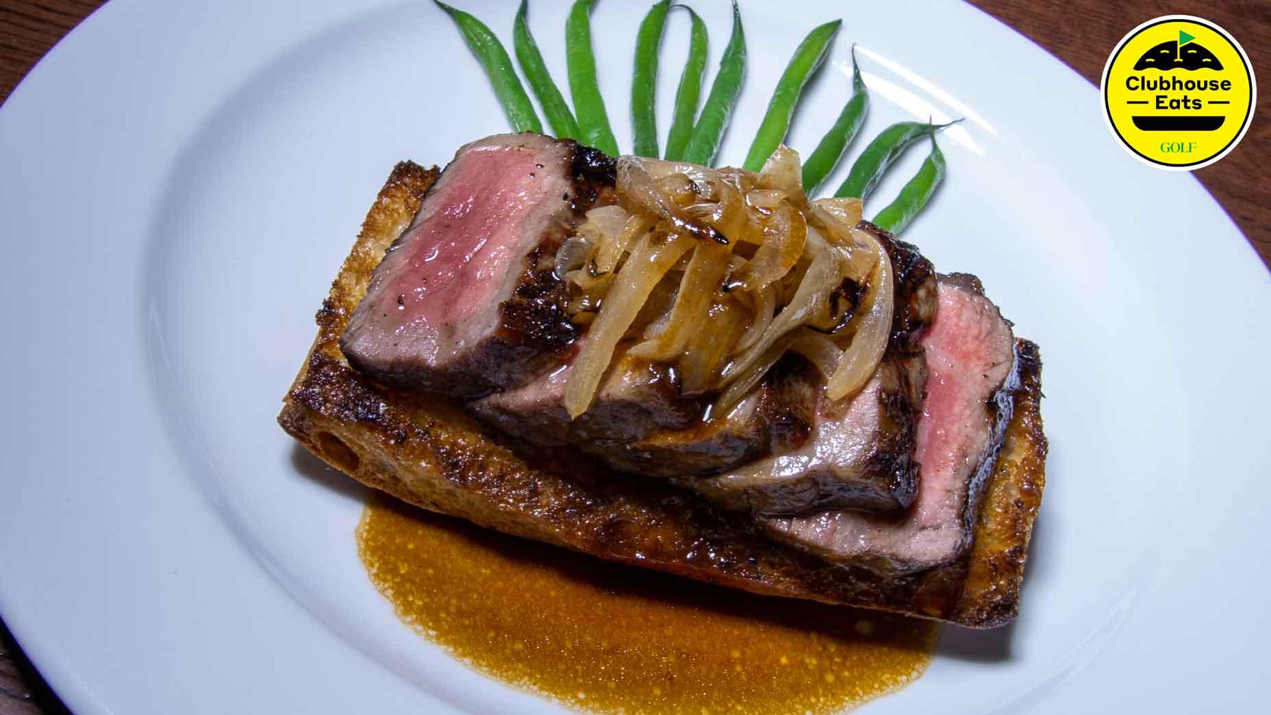 Baltusrol's popular steak sandwich on a plate
