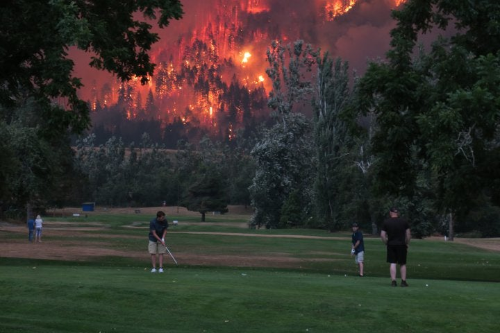 'I saw it while skydiving': The story behind the viral Eagle Creek fire golf photo